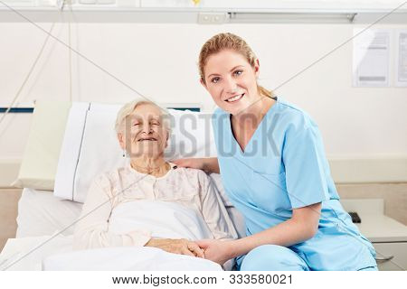 Happy senior woman as a patient with a nurse or caregiver