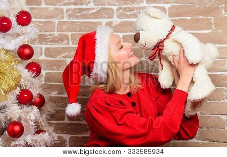 Happy Girl In Santa Hat. New Year Party. Delivery Christmas Gifts. Smiling Woman Celebrating Christm