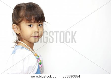 Japanese Girl In A Dress (profile) (4 Years Old)