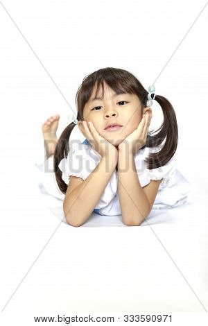 Reclining Japanese Girl In A Dress Resting Chin In Her Hands (4 Years Old)