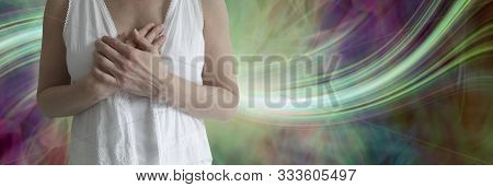 Blessed Be Wiccan Crone Background - Mature Female Wearing White With Hands Held Over Heart Against