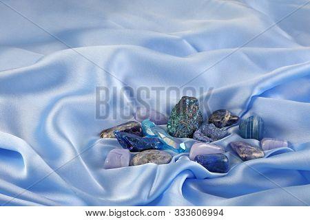 Blue Throat Chakra Healing Crystals On Light Blue Silk - Assorted Blue Coloured Crystal Quartz Miner