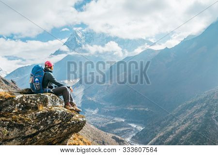 Couple Following Everest Base Camp Trekking Route Near Dughla 4620m. Backpackers Carrying Backpacks