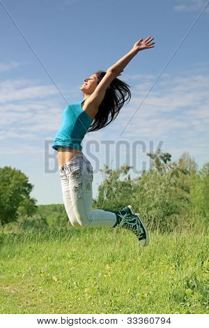 Young Woman In A Beautiful Jump