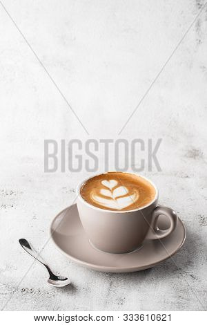 White Cup Of Hot Latte Coffee With Beautiful Milk Foam Latte Art Texture Isolated On Bright Marble B