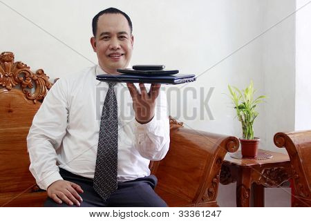 Businessman With Gadget On His Hand