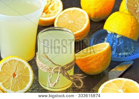 Lemon Fresh And Lemons. Citrus Juice Extractor. The Concept Of Weight Loss With Lemon Juice.