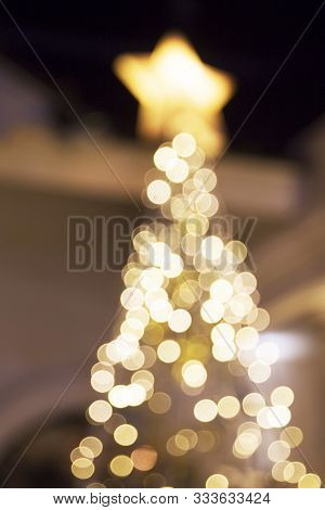 Chirstmas Tree Blurred Lights Closed To House. Festive Concept.