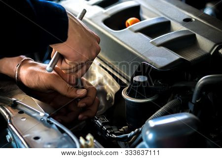 Close Up, People Are Repair A Car Use A Wrench And A Screwdriver To Work. Concept Service By Car.