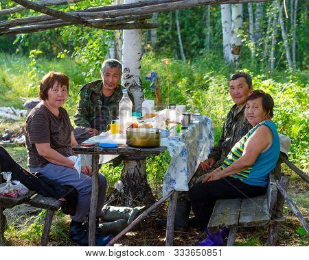 Portrait Of Elderly Asian Women And Men Family Feast In The Northern Yakut Forest In The Afternoon B