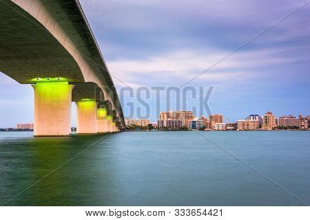 Sarasota, Florida, USA town cityscape from Sarasota Bay at dusk.