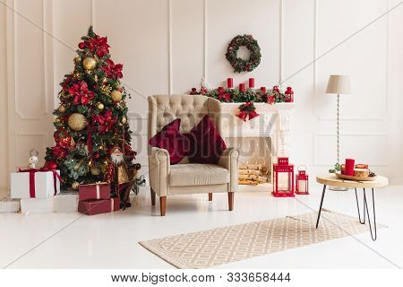 Christmas Interior With Christmas Tree And A Fireplace In Traditional Red Color. Beautiful Christmas