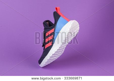 Varna , Bulgaria - August 13, 2019 : Adidas Alta Run Sport Shoe On Purple Background. Product Shot.