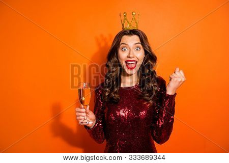 Portrait Of Excited Bachelor Girl Having Crown On Her Head Hold Champagne Hear News About Her Win On