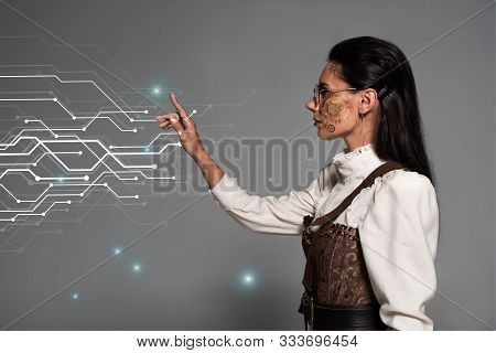 Cropped View Of Steampunk Young Woman In White Blouse Pointing With Finger At Glowing Cyber Illustra