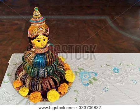 Wedding Bangle Ritual Doll, Is Being Adorned With Colourful Glass Bangles Around.  Very Artistic Ori