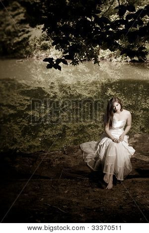 Woman Sitting On A Log, Desaturated