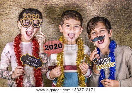Three Cute Kids Celebrating New Years Eve. 2020!