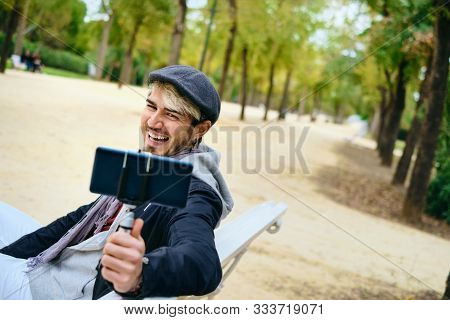 Millennial Man Recording Vlog With Mobile Phone For Social Media