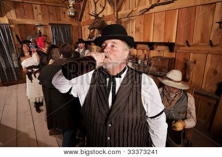 Thirsty Drunkard In Saloon