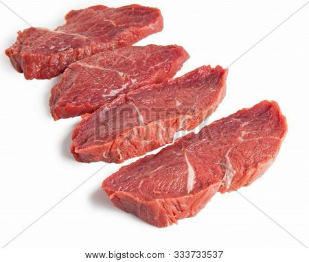 Raw Beef Meal Slices With Specie Isolated On A White Background.