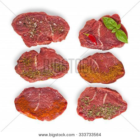 Raw Beef Meal Slices With Specie Isolated On A White Background. Top View.