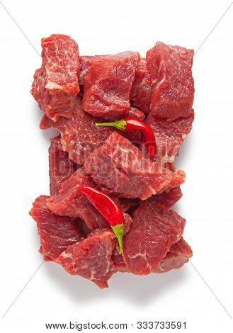 Raw Beef Pieces Isolated On A White Background. Top View.