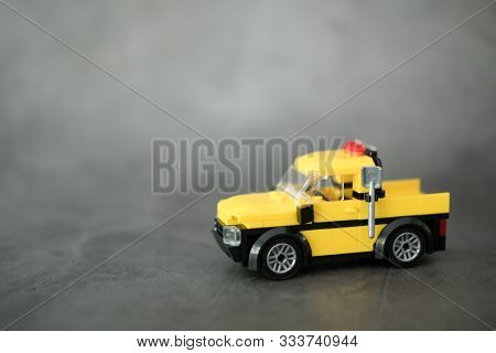 Yellow Car Truck On Black Background. Construction Industry Concept