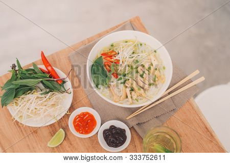 Traditional Vietnamese Noodle Soups Pho In Bowls, Concrete Background. Vietnamese Beef Soup Pho Bo,
