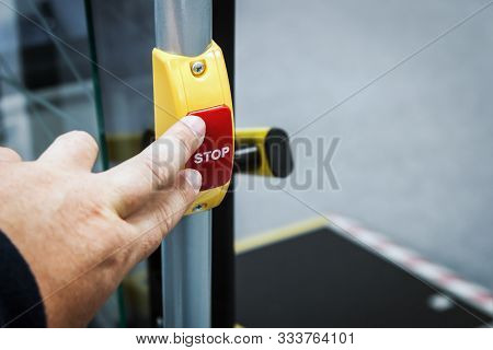 Hand Presses Stop Button In Modern Bus, Electric Bus