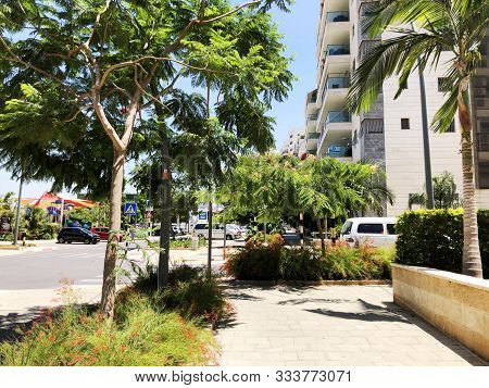 Rishon Le Zion, Israel  October 07, 2019: Residential Buildings And Plants In The Streets Of Rishon