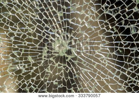 Broken Glass, Cracked Box Or Shockproof Fencing At Fence On The Road. Texture Or Background. Vandali