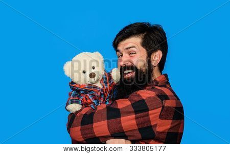 Guy In Plaid Shirt With Teddy Bear. Teddy Bear. Gift And Present Concept. Bearded Man With Teddy Bea