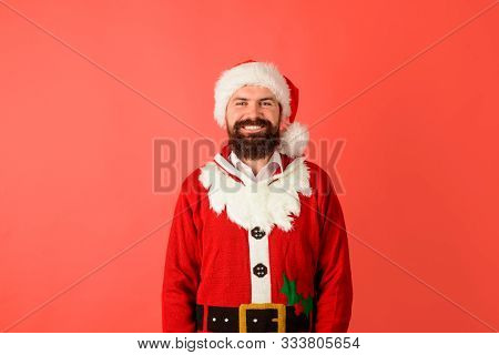 Santa Claus Man. Bearded Man In Santa Claus Costume. Christmas, New Year, Holidays. Smiling Bearded