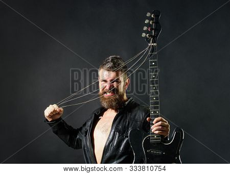 Concert Tour. Rock Or Punk Music Concert. Attractive Man With Guitar. Fashionable Guitarist With Cla