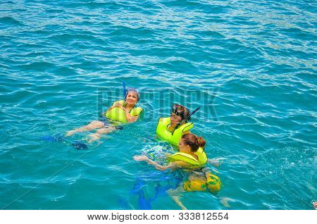 People Swimming Wearing Life Saving Vests In The Pacific Ocean In Cabo San Lucas, Baja California, M