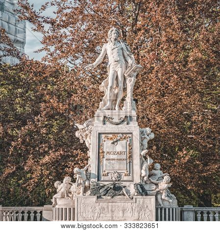 Vienna, Austria - April 27, 2019: Mozart Statue In Mozart Monument With Sunset Golden Cast Over