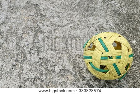 Traditional Sport Of Thailand Rattan Ball Or Takraw On Cement Floor, The Southeast Asia Favorite Spo