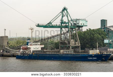 Long Tau River, Vietnam - March 12, 2019: Phuoc Khanh Area. Closeup Of Blue Ship Tuan Minh, Bulk Car