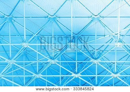 Metal Construction Tinted In Blue Color, Background Concept.