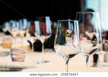 Red Wine Glass On Dinner Table With Friendship