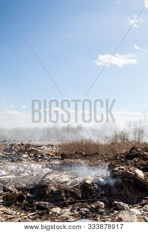 Burning The Garbage On The City Landfill. Smoke Over The Landfill.