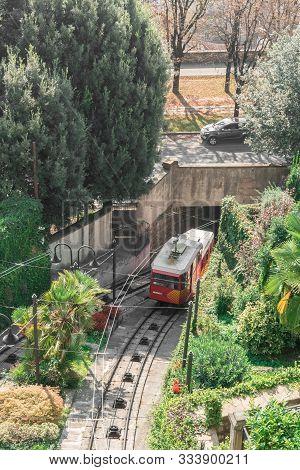 Upper City Funicular Line In Bergamo (funicolare Citta Alta). Red Funicular Connects Old Upper City