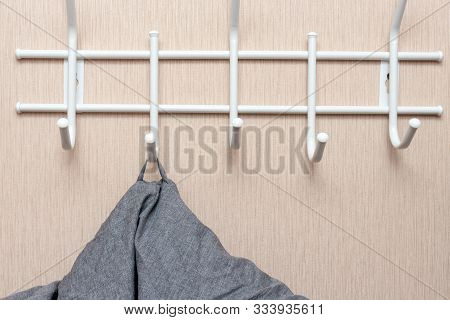 Winter Outerwear, Coat Hanging On A Hook Of A Coat Rack In Hallway, Anteroom At Home.