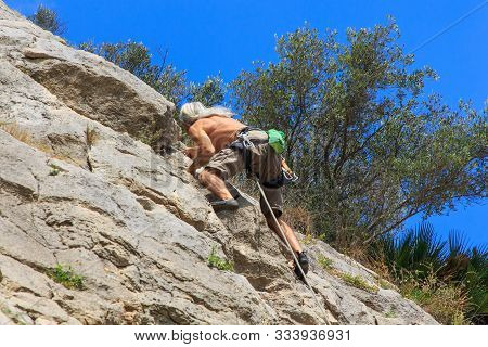 Senior Climber With White Slave Hair.climbing Concept