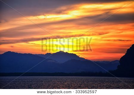 Islands Sunset, Ocean Panorama Views Near Phuket With Deep Red, Orange, Purple And Blue, Mountains,