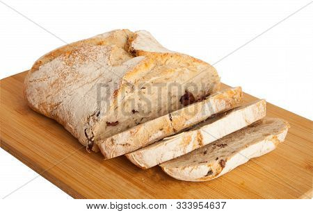 Bread, Ciabatta With Dried Tomatoes And Olives, On A Board, Isolated On White Background