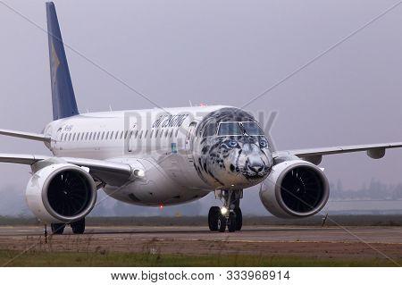 Borispol, Ukraine - November, 14, 2019: P4-kha Air Astana Embraer E190-e2 Aircraft In The Snow Leopa