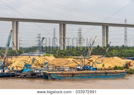 Long Tau River, Vietnam - March 12, 2019: Construction Of Phuoc Khanh Suspension Bridge Under Silver
