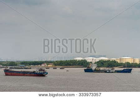 Long Tau River, Vietnam - March 12, 2019: 2 Cargo Vessels On Long Tau River In Front Of Ho Chi Minh